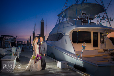 Image of wedding couple at the Bluewater Grill in Wrightsvilee Beach  NC.  Bluewtergrill wedding & reception venue