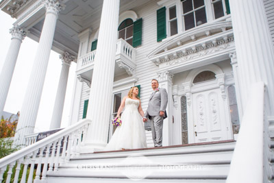 Wedding Couple standing on the steps of Bellamy Mansion - Wilmington NC Wedding Photography