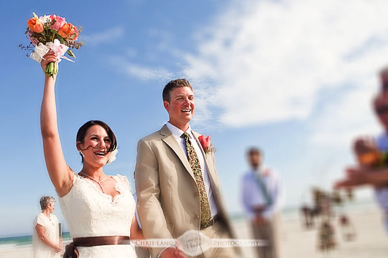 Image of Bride and Groom during beach wedding - Wilmington NC wedding photographers
