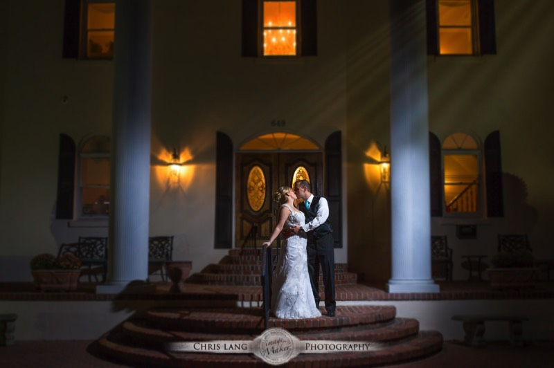 Nght time wedidng picture of newlyweds kissing under the moonlight.  Nighttime wedding photograpy. Wedding picture ideas.  Wilmington NC Wedding Photographer