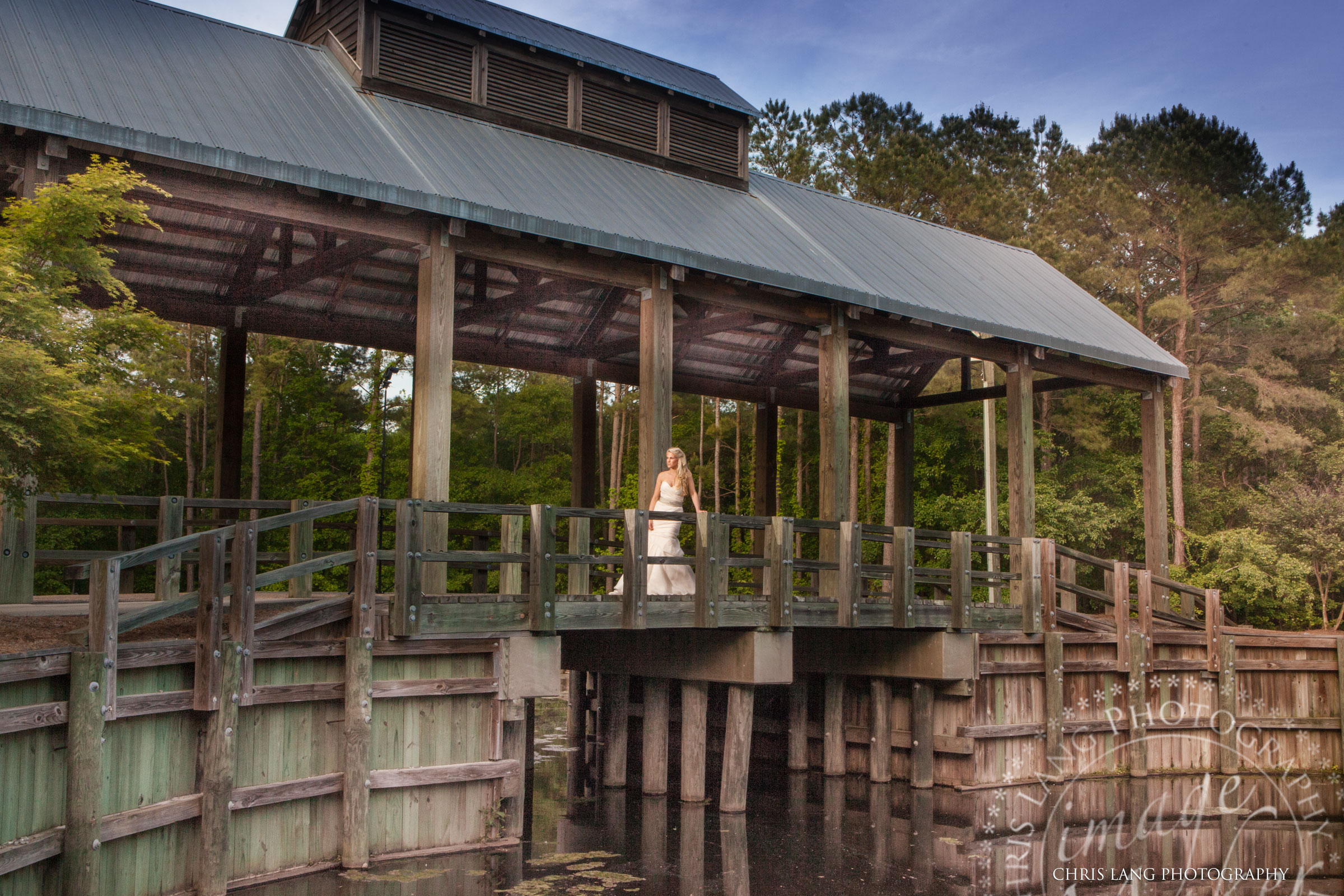 North Carolina Wedding Photographers - Image of Bride on a covered brodge - Wedding Ideas - Vintage Weddings