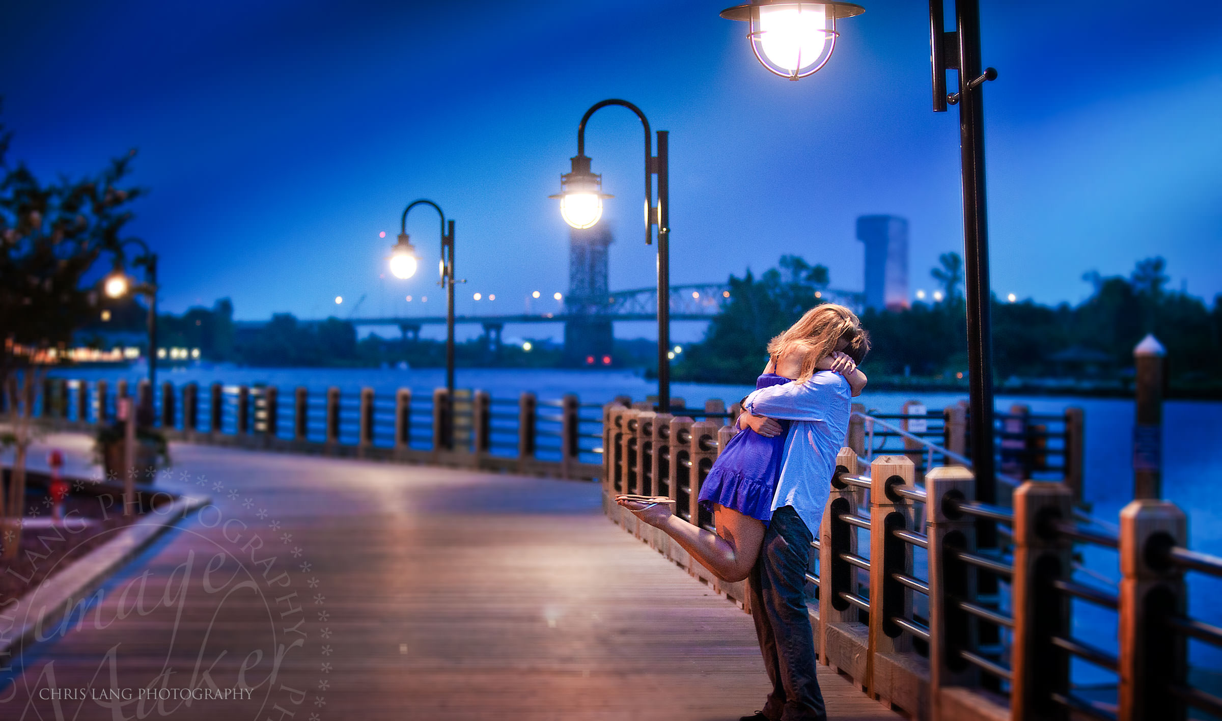 Image of engaged couple on the Cape Fear River Deck - Wilmington NC Engagement Photographers